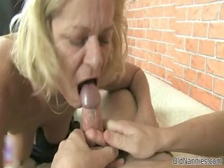nasty golden-haired old woman sucks on a pecker