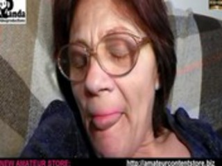 granny lisa dildoing in armchair