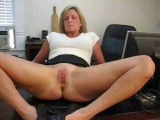 older blonde secretary widens her legs and