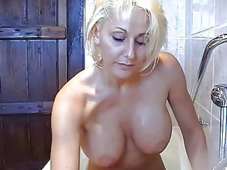 bootylicious busty golden-haired momma plays with