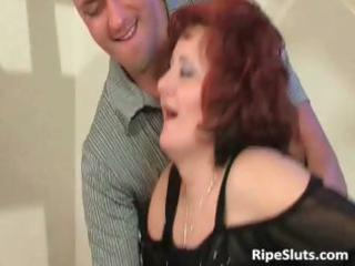 mature redhead with large boobs receives that is