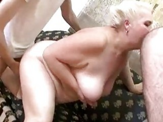 mature servicing two juvenile cocks