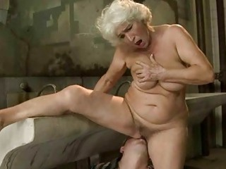 Busty granny gets fucked in public toilet