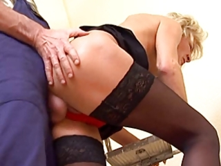 slim blond mature in stockings copulates the