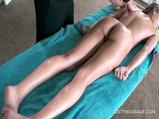 hot babe acquires undressed body massaged with oil
