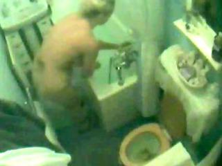 curvy blond wife bathing