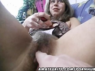 curly dilettante wife toys and rides a cock with