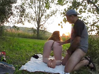 breasty redhead sucks and copulates outside and