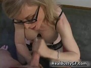 golden-haired mamma in glasses licking inflexible