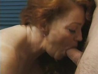 redhead granny receives busy