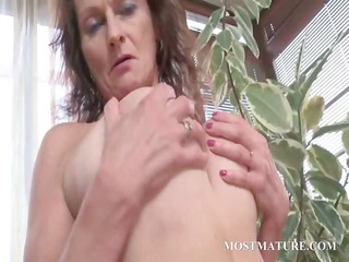bare cougar works breasts and bushy cunt