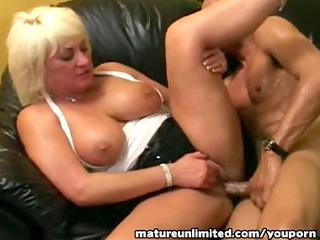 mature shakes her large tits....