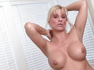 stylish golden-haired milf disrobes and pokes her