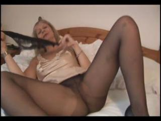 breasty mature blonde in hose takes em off and